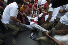 Police detained a Communist Party of India (Marxist) protester in Hyderabad, India, Monday. People rallied against a hike in electricity and water prices. (Mahesh Kumar A./Associated Press)