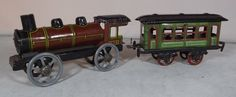 Antiques Atlas - German Tin-Plate Train & Carriage Penny Toy C.1910