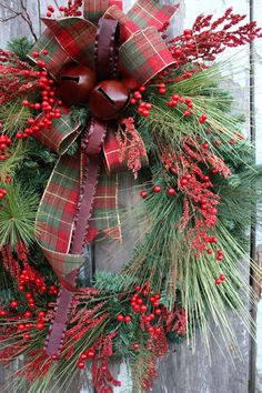 easy DIY wreath with mixed conifer cuttings from the yard and some plaid ribbon . . .love