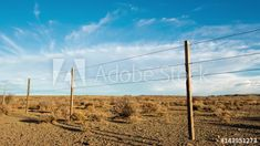 Stock Footage of A static timelapse with a slow pan of a typical Karoo farm landscape with a sheep fence in the foreground and scattered clouds (stratus, altostratus, cumulous) against a bright blue sky. Explore similar videos at Adobe Stock Sheep Fence, A Typical, Rock Formations, Windmill, Geology, Stock Video, Stock Footage, South Africa, Adobe