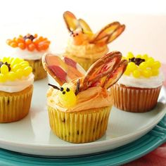 These sweet cupcakes are decorated to look like flowers and butterflies.