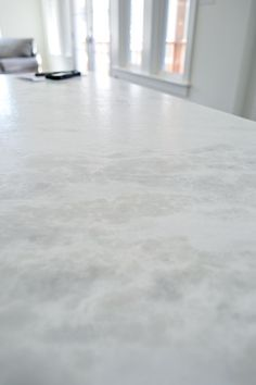 l Leathered marble called White Moura which means that rather than having a smooth, glossy finish it has a slightly pebbled texture to it, along with a more matte finish.