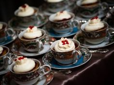 cupcakes in teacups. maybe I could find cheapo plastic teacups and spray paint them so they look fancified.