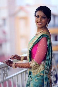 #Gorgeous #SouthIndian Bride. Temple jewelry. Jhumkis. Blue teal silk Kanchipuram #Saree with cutwork and contrast pink sheer blouse.Braid with fresh jasmine flowers.