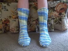 Here is a wonderful pair of hand knit adult size socks. Heel to toe is approx. 9 1/2 in. and the ribbing on the top (top to ankle) is approx. 6 1/2 in. The color yarn used is called French Country which is a multi- colored yarn that consists of several different colors such as blue, light blue, yellow and white. These socks are made of 100% acrylic yarn and can be machine washed and dried.