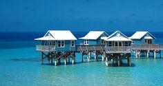 Cabanas on stilts at 9 Beaches Resort in Bermuda.