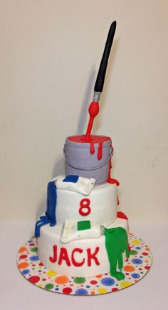 Art birthday cake. Illusion / gravity 2 tier cake with fondant paint tubes. Cake Paint can topper with suspended paint brush.