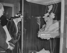 Queen Elizabeth II inspects the dress worn by Anna Pavlova, made from swan feathers, for her performance of 'Swan Lake', during a visit to the Pavolva Commemorative Exhibition at the London Museum, November Young Queen Elizabeth, Anna Pavlova, Vintage Dance, London Museums, Dance Photos, Fairy Land, The Conjuring, Stock Pictures, Royalty Free Photos