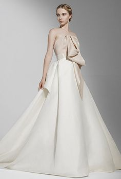 Peter Langner. Ball gown with origami folds on bodice and beaded belt at waist.