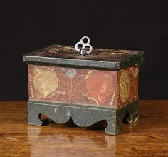 A Small 19th Century Folk Art Box naively painted with flowers in sponged d
