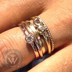 Custom crafted by Daniel and Sara at our workshop in Weiss Jewelry in Los Angeles: 14k yellow gold stackable hand-fabricated, handmade bezel set diamond rings. Our very own Tisha's stack of the day. What's your stack look like today? Send us a pic and we will post it! #handmade #handcrafted #handfinished #handset #stackables #stackablebands #stacks #ropering #weissjewelry #ring #14K #gold #stackoftheday #jewelry #customcrafted #losangeles #madetoorder #saraweiss #danielweiss #farmersmarketla…