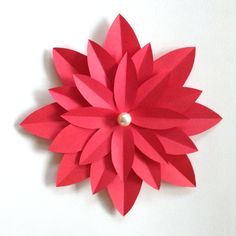 Paper Poinsettia with large pearl bead for its center.