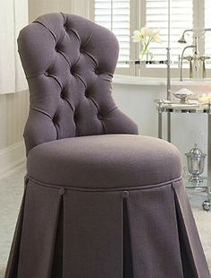 Complete your daily beauty routine in comfort and style atop the Sabrina Vanity Stool that boasts a stunning tufted back, thick cushion and draped, pleated skirt for added sophistication.