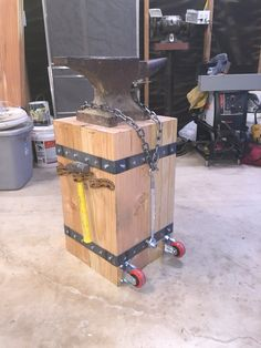 """Anvil stand made with 8x8s, 2"""" strap, 2 wheels and leather tool loops"""
