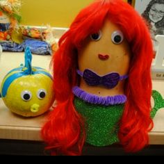 Pumpkin and squash I decorated last year for our office decorating competition. Ariel & Flounder from The Little Mermaid <3