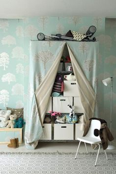 Light Blue Nursery with Fabric Covered Wire Shelves Storing Toys