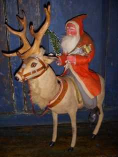 German Santa on huge clockwork reindeer