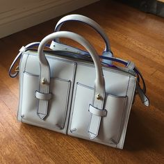 """Pastel Leather Joy Gryson Handbag Only worn once! 🤖 Gorgeous baby blue color, brass hardware and a shoebag/lining that can be unsnapped (depending on how you'd like to use it). Two exterior pockets on the front and an easily adjustable strap that hangs approx 18"""" below the shoulder on the medium setting. IIIBeCa by Joy Gryson Bags Shoulder Bags"""