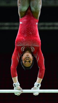 #RIO2016 US gymnast Gabrielle Douglas practices on the uneven bars of the women's Artistic gymnastics at the Olympic Arena on August 4 2016 ahead of the Rio...