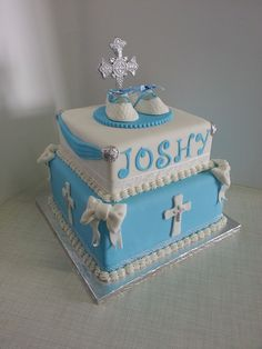 Christening cake for Joshy with fondant shoes and cross