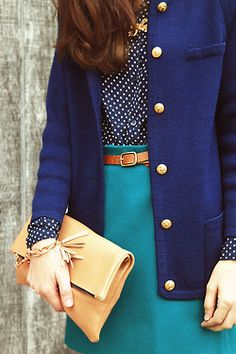 turquoise skirt, navy polka dot shirt, royal blue cardigan with gold buttons, and that hair