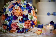 Peach, blue, purple, coral, and white bridal bouquet of fresh roses, garden roses, orchids, peonies, stephanotis, stock, and hydrangea and accented with genuine Swarovski crystals. Designed by Something Spectacular / Something Floral (Warren, MI). #bridal #bouquet #wedding #flowers #peach #coral #blue #purple #white #roses #orchids #dendrobium #stephanotis #peonies #hydrangea