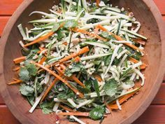 Matchstick ribbons of zucchini and carrot, grassy, fresh herbs, and roasted peanuts mingle with a pungent, savory, tart dressing in this summer salad.