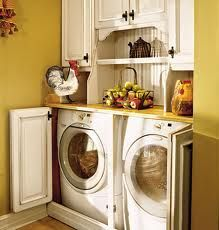 Other than the rooster this little laundry nook is adorable. I love that the cabinets can close and hide the washer and dryer from view.