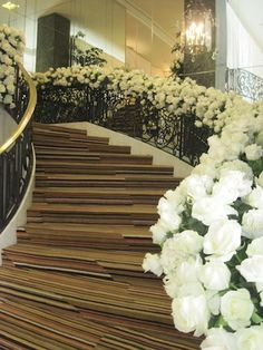 White roses cover the staircase railings at this Beverly Wilshire wedding.
