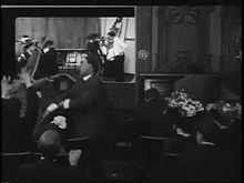 """Those Awful Hats is a 1909 American short comedy film directed by D.W. Griffith. It takes place in a small, crowded movie theatre, where the patrons are perpetually distracted by people - primarily women - wearing large, ostentatious hats that obstruct everyone else's views of the screen. The film ends with a title card reading, """"Ladies Will Please Remove Their Hats."""" A print of the film survives in the film archive of the Library of Congress."""
