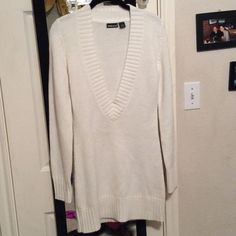 Wet seal long deep v neck sweater Wet seal long deep v neck sweater, size m, very comfortable, worn once realizing I bought the wrong size. Wet Seal Sweaters V-Necks