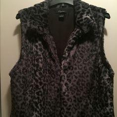 Leopard faux fur vest Beautiful, soft, brand new, gray and black leopard print fur vest. Fully lined. Great peice.  Cejon Tops