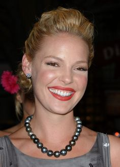 Katherine Heigl paired her elegant gown with a classic black pearl necklace.