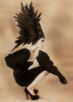 This is one of all-time favorite pics. It's from the Black Swan collection by Aquage artist Shawna Parvin. Love the hair feathers and model's attitude!