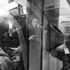 On the tube (2). Shot exclusively on the iPhone, and processed through Instagram, this series began in January 2015 and is ongoing. I use the glass panels and reflections on the London Underground as a canvas to see and capture the people as they travel and wonder in their day to day lives. They don't know I'm taking the picture, I believe they think I am taking selfies (something I never do). Walker Evans and Bruce Davidson are the most obvious references, but I am not just looking at the…