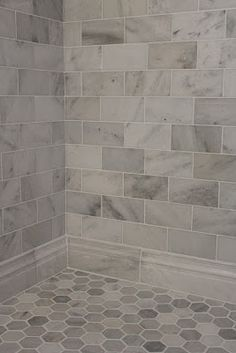 Large gray and white marble subway tile on shower wall and baseboard with a hexagon pattern on the floor. Large gray and white marble subway tile on shower wall and baseboard with a hexagon pattern on the floor. Upstairs Bathrooms, Basement Bathroom, Dream Bathrooms, Beautiful Bathrooms, Bathroom Gray, Bathroom Marble, Bathroom Remodeling, Remodeling Ideas, Bathroom Flooring