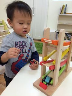 Our toddlers just love this race car track! It is a great way to let them practice their visual tracking skills. The students will drop a car each time from the top of the track and follow it with their eyes until it gets to the bottom of the track.