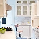 kitchens - oil rubbed bronze ceiling fixture industrial vintage architect stool white glass front shaker kitchen cabinets marble countertops marble subway tiles backsplash warm wood floors