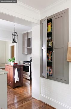 What an efficient built-in pantry--great idea when space is limited--might be able to steal this space from room or closet behind.