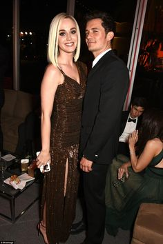 Look of love: Katy hung with her boyfriend Orlando Bloom, 40, who smoldered in a fitted bl...