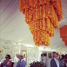 An intricate floral chandelier in @VeuveClicquot signature yellow hue Champagne #SpaStyle