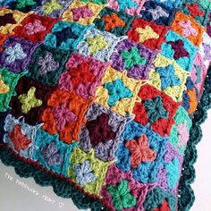 Crochet pillow cover using small granny squares