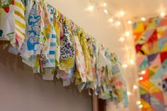 love this .... strips of fabric tied around a curtain rod for a valance ....
