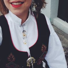 The Norwegian National costume, at Norway's independence day. Silver, red lipstick.