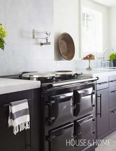 Photo Gallery: 2012 Princess Margaret Showhome | House & Home Ikea cabinets are built out to sit flush with the Aga range. The cooker is electric.