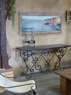 Hand painted shutter doors.  Custom made iron and concrete console table.