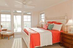 Coral bedding in a beachy bedroom How Colors and Mood Affect the Interior Design of Your Home