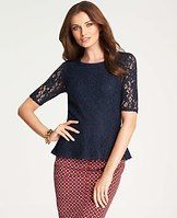 Symphony Lace Peplum Top - Styled with a waist-cinching peplum hem, this lovely lace confection is a truly romantic have-to-have. Mix it up with contrasting patterns for a chic graphic twist. Jewel neck. Short sleeves. Hidden side zipper. Lined body, unlined sleeves.