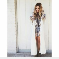 *editor pick* Free people fringed kimono cardigan Over sized long kimono style cardi. Lightweight subtle pinstripes with fringe trim  Wear it over anything!  One size. Ivory. NWT $ 168  all prices are negotioable Bundle and save the most! Free People Sweaters