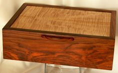 Rich unique jewelry box In Cocobolo, with a beautiful Curly Maple lid, an ideal gift for any occasion.This is a classy piece!